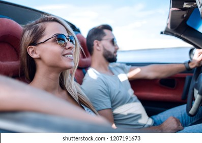 close up.the couple traveling in a convertible