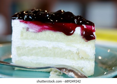 Close up, Delicious, A piece of blue berry cheesecake on blue dish with teaspoon
