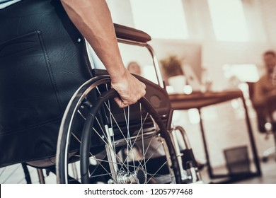 Close up. Disabled Man on Wheelchair in Office. Disabled Young Man. Man on Wheelchair. Recovery and Healthcare Concepts. Teamwork in Office. Young Workers. Sitting Man. Happy Worker.