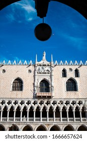 Close up. The Doge's Palace is a palace built in Venetian Gothic style, the main landmark of the city of Venice in northern Italy, Veneto. The white building facade with arches, shutters and columns