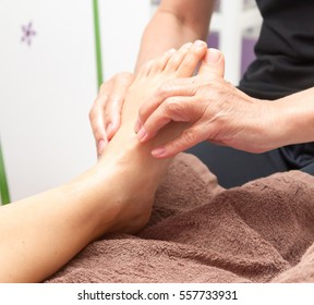 Close up, female hand doing foot massage