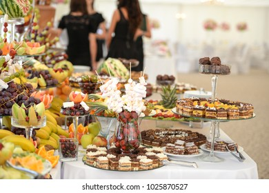 close up. fresh fruits cakes and sweets in a candy bar