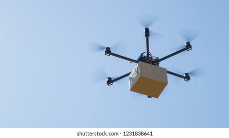 CLOSE UP: Futuristic package shipment by helicopter drone. Air cargo delivery