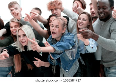 close up. a group of young people pointing at one point