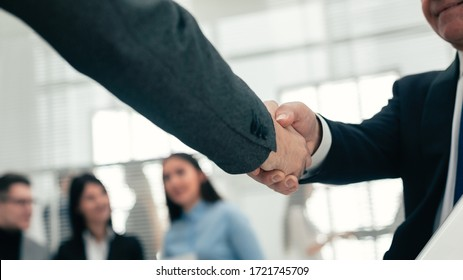 close up. handshake of business partners in the background of the office.