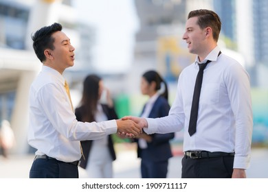 Close up, Handshake of two businessmen on the background of modern office, partnership concept, Shaking hands to seal a deal