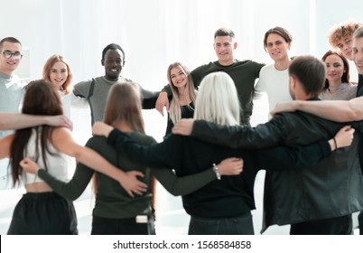 close up. happy young people standing in a circle.