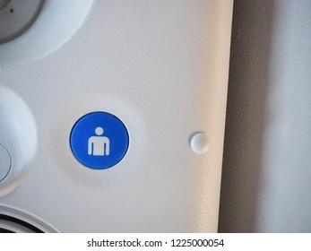 Close up,  Help needed button on overhead compartment. Economy class on low cost airline business seated. Travel concept.