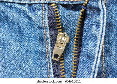 Close up, Jeans Zipper pants crash. It is a serious mistake to dress.