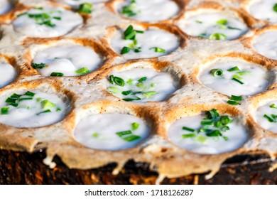 Close -up Ka Nom Kork  Traditional Thai dessert , sweetmeat on cooking pan with coconut milk