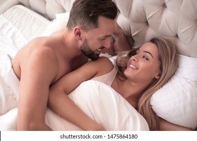 close up. a loving couple waking up together.