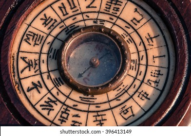 Close up, macro photo antique chinese compass with sunlight in sunset