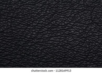 close up, macro shot of natural black leather texture background, space leather for rock fashion trend, dark tone style, theme, concept, design, leather jacket, bag, belt, shoes