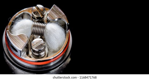 close up, macro shot of single micro coil with japanese organic cotton wick in high end rebuildable dripping tank atomizer for flavour chaser, vaping device, vape gear, vaporizer equipment
