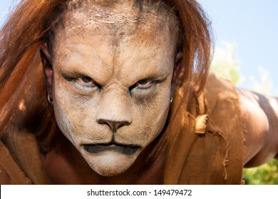 Close -up and meancing face of a Lion man looking into the camera.  Fantastic special FX make up of Rayce Bird.