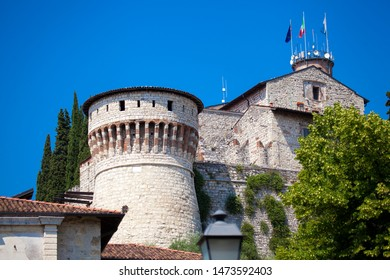 Close up. Medieval castle (Castello di Brescia) with battlements, a tower, drawbridge & ramparts, plus an arms museum in the keep. Brescia, Lombardy, Italy. Italian architecture. Roman ancient castle.