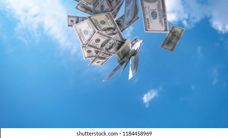 CLOSE UP: Money falling from the sky. Hundred dollar bills falling down from blue skies. Successful business bringing piles of money. Profitable job and big salary. Winning the lottery