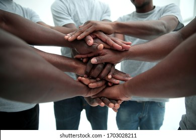 close up. a multi-ethnic group of friends showing their unity