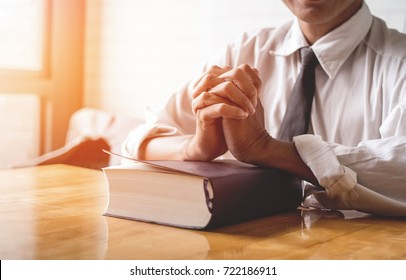 close up, the pastor laid hands on the black book of the Bible, Buddhist, Catholic, Christian, prayer, and pray for blessings from God, all people are safe from harm.