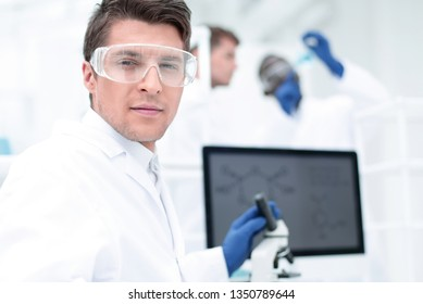 close up. scientist microbiologist at the laboratory table