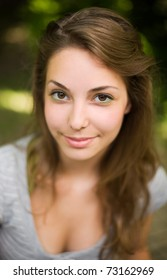 Close up, shallow-dof portrait of a beautiful young brunette.