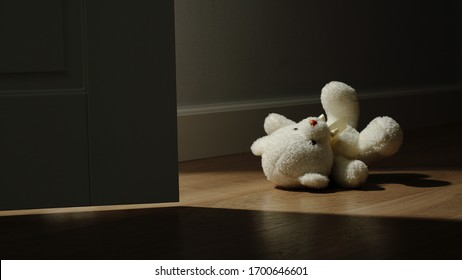 CLOSE UP: Small Plush Bear Toy Is Thrown On The Floor At Home