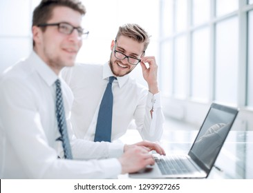 close up.two successful employees sitting at the Desk