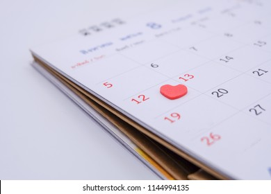 Close up: Thai calendar (August). 12 August of every year is Mothers' Day in Thailand. Important days concept. There is a red heart shape on Date,12
