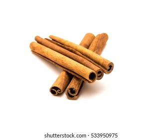 Close up, top view of pile of raw cinnamon sticks isolated on white background.