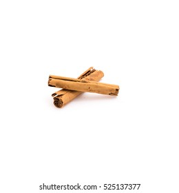 Close up, top view of three raw cinnamon sticks isolated on white background.