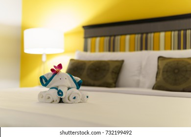 close up, Towels are folded into elephants shape for bathroom accessories preparation on the bed in a room of hotel or apartment. well preparation of bath facilities for hotel services for hotel guest