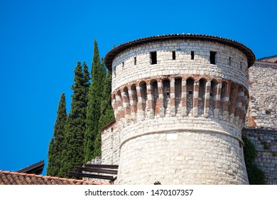 Close up. The tower of a medieval castle (Castello di Brescia) made of white bricks in the 14th century. Brescia, Lombardy, Italy. Italian architecture. Roman ancient castle.
