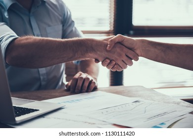 Close up. Two Businessmen Shaking Hands after Discussion. Discussion of Successes at Meeting in Modern Office. Agreement after Discussion Concept. Successful Partnership in Business Concepts.