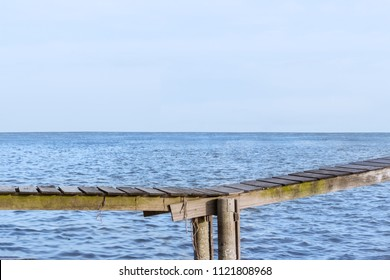 close up, wooden bridge with sea
