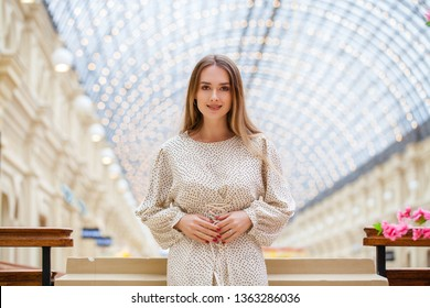 Close up, Young beautiful blonde woman in white blouse, indoor