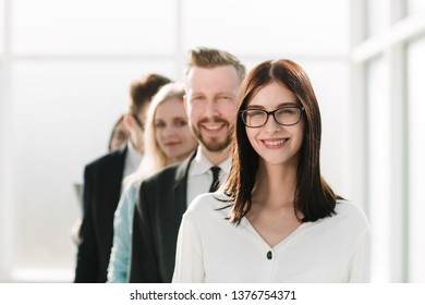 close up. young businesswoman standing in front of the business team