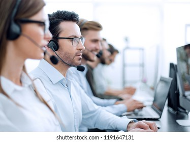 close up.background image of call center employees in the workplace
