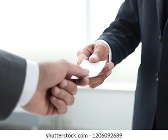 close up.business hands over his business card.