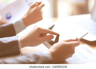 close up.businessman checking financial data on digital tablet