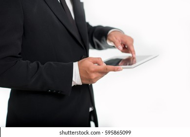 Close up,businessman holding tablet in suit
