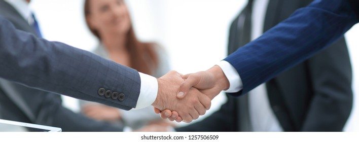 close up.businessmen shaking hands