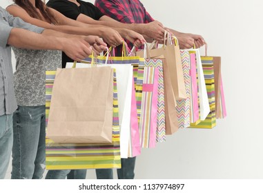 close up.buyers showing their colorful shopping bags