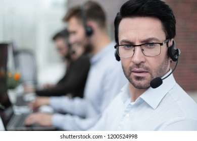 close up.call center operator on the background of the office