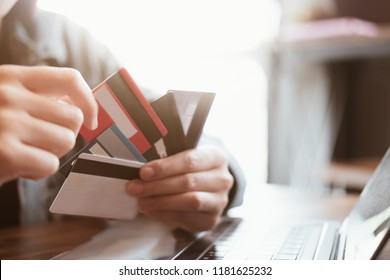 Close up.Hands holding credit card and using laptop. Online shopping