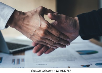 close up.handshake business partners agree to contract Real Estate Venture International trade, investment in meetings vision to invest for profit.