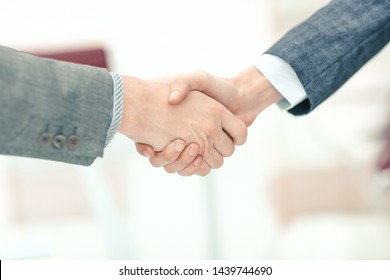 close up.handshake business partners in the workplace in the office