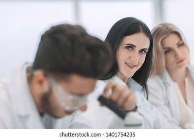 close up.modern woman scientist in the workplace in the laboratory.