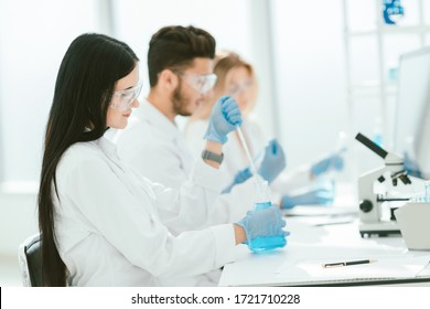 close up.modern woman sitting with colleagues at the laboratory