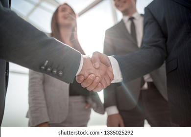 close up.reliable handshake of business partners