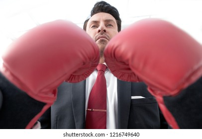 close up.serious businessman in Boxing gloves